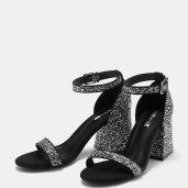 https://www.bershka.com/fr/femme/chaussures/sandales-%C3%A0-talons/sandales-%C3%A0-paillettes-attach%C3%A9es-%C3%A0-la-cheville-%C3%A0-talon-moyen-c1010193198p101096019.html?colorId=040