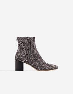 https://www.stradivarius.com/fr/femme/chaussures/bottes-et-bottines/bottine-talon-midi-paillettes-c1399019p300421001.html?colorId=092&style=09